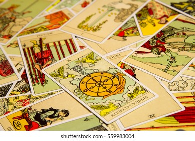 Moscow, Russia - December 4, 2016: Tarot card Wheel of Fortune with other cards. Rider-Waite tarot deck. Esoteric background