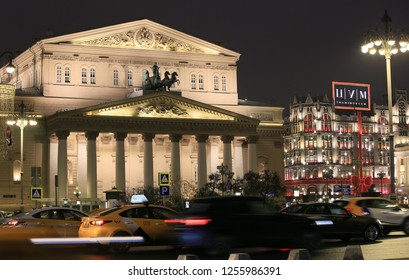 Moscow, Russia, December 4, 2018. Theater Square at night, view of the building of the Bolshoi Theater and the building of the central department store, cityscape