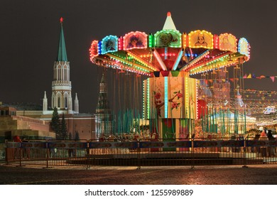 Moscow, Russia, December 4, 2018. Christmas decorations, fair and carousel in Red Square. Christmas Market in the evening city