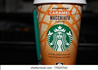 MOSCOW, RUSSIA - DECEMBER 6, 2017: Starbucks Coffee Take Away Cup. New Format of Starbucks Coffee, Take Out Drinks Selling at Grocery Shops. Plastic Cup with Brand Logo Isolated on Dark Background.