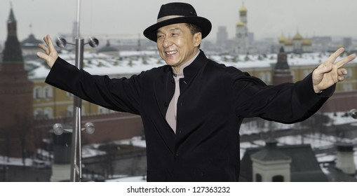 "MOSCOW, RUSSIA - DECEMBER 6: Jackie Chan poses at a hotel during a photo call for the new film ""Armour of God III, Chinese Zodiac"" with the Kremlin in background, on December 6, 2012 in Moscow"