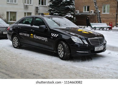 MOSCOW - RUSSIA, DECEMBER 9, 2013: russian black Mercedes-Benz E-classe taxi car on the Moscow street