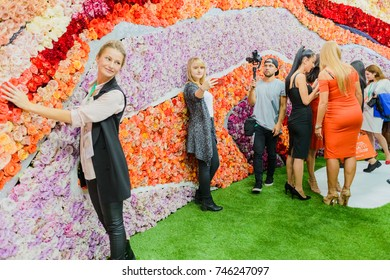 Moscow, Russia, Expocenter VDNH - OCTOBER 4-7, 2017: Russian agro industrial exhibition Golden autumn. Business stand- production company Ural chemical, wall of living roses.