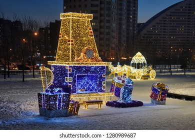 MOSCOW, RUSSIA - Fairytale fireplace with clock and new year gifts of Grandfather the Frost (Russian Santa) and carriage - beautiful light installations in the park on on Khodynskoye Pole.