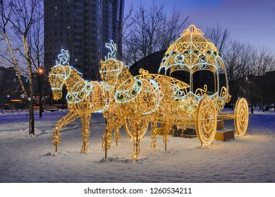 MOSCOW, RUSSIA - Fairytale Light Horses with a Carriage in Winter Twilight. New Year decoration in the new Moscow park on Khodynskoye Pole,