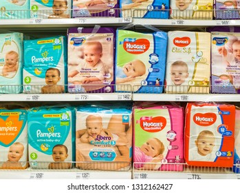 Moscow, Russia - Feb 12. 2019. diapers for children in large store network Auchan