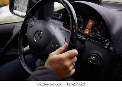MOSCOW, RUSSIA - FEB 2, 2018: Male hand on steering wheel of Mersedes-Benz car.