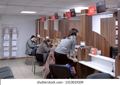 """Moscow, Russia - Feb 2019: """"My Documents"""" - Center of State and Municipal Services. Inside at multifunctionals center for providing state and municipal services. Social workers talking with clients."""