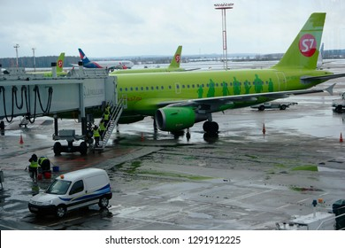 Moscow, Russia Feb. 26, 2016: S7 Siberian Airlines Airliner in Domodedovo Airport Loading. View from terminal. S7 is member of OneWorld Alliance.