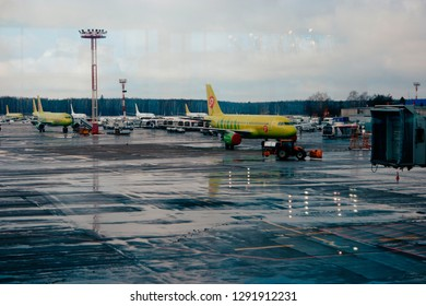 Moscow, Russia Feb. 26, 2016: S7 Siberian Airlines Airliner in Domodedovo Airport. View from terminal. S7 is member of OneWorld Alliance.
