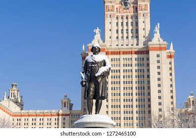 Moscow, Russia - Febriary 6, 2018: Monument to the founder of Moscow University, Mikhail Lomonosov against the background of the Main Building of Moscow State University. Sunny day in February