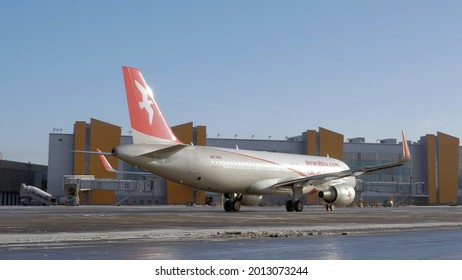 MOSCOW, RUSSIA - FEBRUARY 01, 2018: Airplane A320 of Air Arabia airline taxiing to the Terminal E at Sheremetyevo Airport. Emirati low-cost airline operating 155 destinations