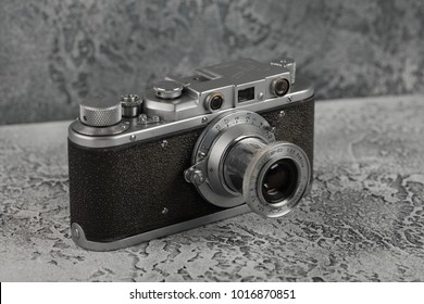 MOSCOW, RUSSIA, FEBRUARY 04, 2018 The old Soviet rangefinder camera Zorki, released 1952 on the background of gray cement.