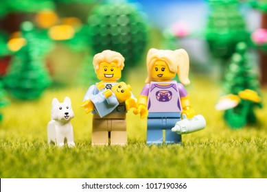Moscow, Russia - FEBRUARY 04, 2018: Lego minifigures - famili with baby and dog