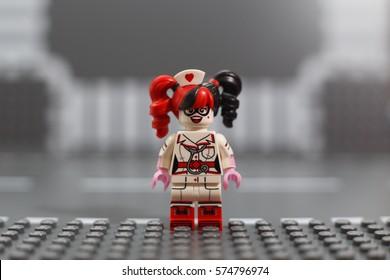 Moscow, Russia - FEBRUARY 05, 2017: THE LEGO BATMAN MOVIE minifigure - Nurse Harley Quinn on Lego gray baseplate background. Studio shot