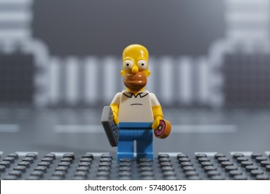 Moscow, Russia - FEBRUARY 05, 2017: One Lego minifigure - Homer Simpson on Lego gray baseplate background. Studio shot