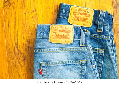 Moscow, Russia, February 06, 2015: close up of the Levis yellow label on the back pocket of a two pair of denim jeans. Levis is a brand name of Levi Strauss, founded in 1853. model 512