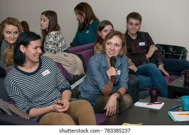 MOSCOW, RUSSIA - FEBRUARY 07: Group of young Russian people on are listening carefully one of talk partner at the public meeting on learning English on February 07, 2015 in Moscow, Russia.