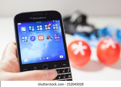 Moscow, Russia - February 1, 2015: Woman holding a BlackBerry Classic displaying icons on the screen, against accessorizes. It was released on December 17, 2014.