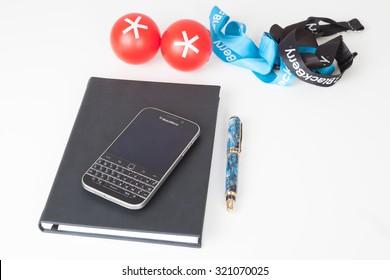 Moscow, Russia - February 1, 2015: BlackBerry Classic smartphone, notebook, pen and accessorizes. It was released on December 17, 2014.