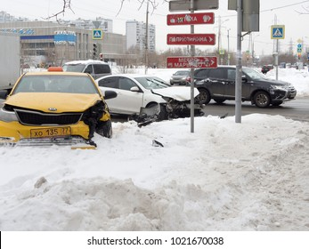 MOSCOW, RUSSIA - FEBRUARY 10, 2018: Accident two cars at the intersection of the slippery road