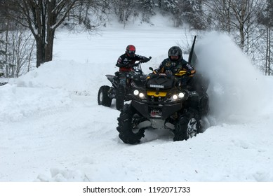 MOSCOW, RUSSIA - FEBRUARY 10, 2018: Sports quad bike rushes on the snow-covered road in the forest. Russian Outpost Winter 2018, Golygino village, Sergiev Posad district