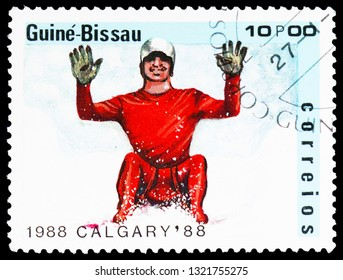 MOSCOW, RUSSIA - FEBRUARY 10, 2019: A stamp printed in Guinea-Bissau shows Luge, Olympic Games 1988 - Calgary serie, circa 1988