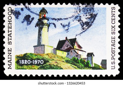 """MOSCOW, RUSSIA - FEBRUARY 10, 2019: A stamp printed in United States devoted to 150 Years Maine Statehood, shows """"Lighthouse at Two Lights"""" by Edward Hopper, serie, circa 1970"""