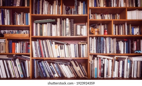Moscow, Russia - February 10, 2021: Wooden shelves filled with books on different languages.