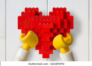 Moscow, Russia - FEBRUARY 11, 2018: Lego Love -man keeps heart from lego