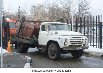 MOSCOW, RUSSIA - February 13, 2015: The old white truck ZIL drives in snow melting point in Moscow