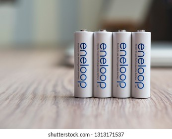 Moscow, Russia - February 13, 2019: Japan made Panasonic Eneloop ready to use rechargeable batteries on the table, shallow depth of field