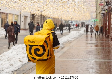 MOSCOW, RUSSIA - FEBRUARY 13,2019: A man from the delivery service of food - Yandex Eda, on the streets of city.food delivery