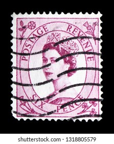 MOSCOW, RUSSIA - FEBRUARY 14, 2019: A stamp printed in United Kingdom shows Queen Elizabeth II - Predecimal Wilding serie, circa 1960