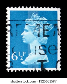 MOSCOW, RUSSIA - FEBRUARY 14, 2019: A stamp printed in United Kingdom shows Queen Elizabeth II - Decimal Machin serie, circa 1977