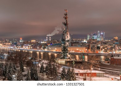 MOSCOW, RUSSIA - February 14, 2019. Aerial view to the iluminated city center of Moscow during evening time. Monument to Peter the Great