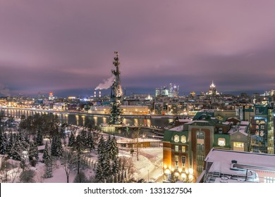 MOSCOW, RUSSIA - February 14, 2019. Aerial view to the iluminated city center of Moscow during evening time. Frozen Moscow riwer