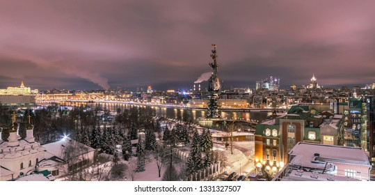 MOSCOW, RUSSIA - February 14, 2019 Panorama view to the illuminated city center of Moscow at night. Frozen Moscow riwer