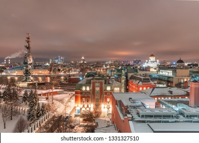 MOSCOW, RUSSIA - February 14, 2019. Aerial view to the iluminated city center of Moscow at night time. Monument to Peter the Great and Christ the Savior Cathedral