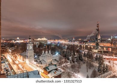 MOSCOW, RUSSIA - February 14, 2019. Aerial view to the iluminated city center of Moscow during evening time. Monument to Peter the Great and Church of St. Nicholas