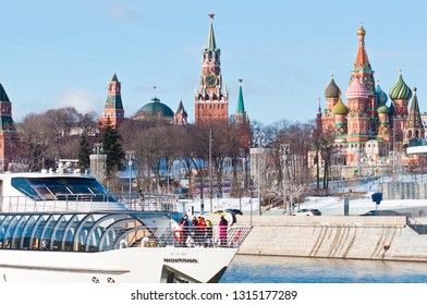 MOSCOW, RUSSIA - FEBRUARY 16, 2019: Spasskaya Tower and Cathedral of Vasily the Blessed (Saint Basil's Cathedral) on Red Square and Radisson Royal Flotilla yacht in sunny winter day