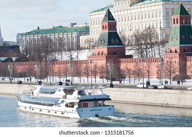 MOSCOW, RUSSIA - FEBRUARY 16, 2019: The Radisson Royal Flotilla yacht near Moscow Kremlin. Moskva river. Winter sunny day