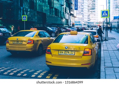 Moscow, Russia — February 18, 2019: Yandex Taxi car near Moscow International Business Center (Moscow-City skyscrapers).