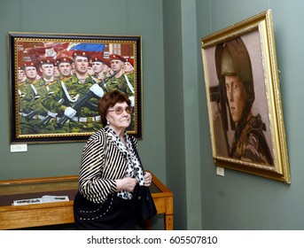 MOSCOW, RUSSIA - FEBRUARY 19, 2015:Viewers at the exhibition in Moscow state school of watercolour of Sergei Andriyaka in Gorokhovsky lane.