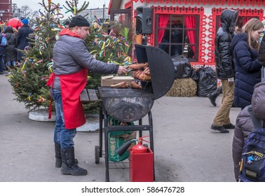 MOSCOW, RUSSIA - FEBRUARY 19, 2017; Shrovetide carnival celebration. Seller grill chicken legs.