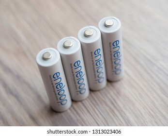 Moscow, Russia - February 19, 2019: Japan made Panasonic Eneloop ready to use rechargeable batteries close-up, high angle view