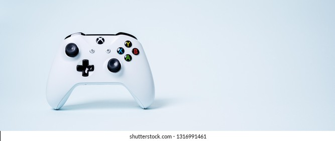 Moscow, Russia - February 19 2019: Gamepad XBOX controller joystick  on blue pastel background with copy space. Long wide banner with Creative Minimal Gaming concept.