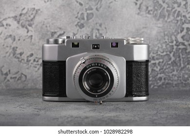 MOSCOW, RUSSIA, FEBRUARY 20, 2018. The old Soviet rangefinder film camera Junost, released 1959 on a grey cement background.
