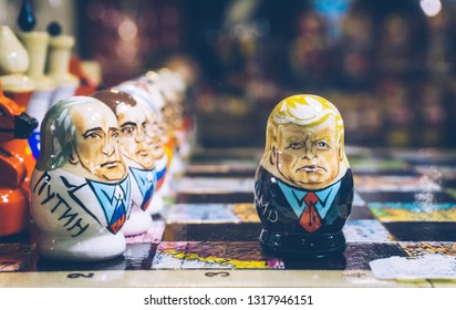 Moscow, Russia — February 20, 2019: Trump and Putin as Russian nesting dolls (Matryoshka doll, Russian doll). The policy of Russia and America. Cartoon, caricature.