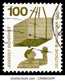 MOSCOW, RUSSIA - FEBRUARY 20, 2019: A stamp printed in Germany, Federal Republic, shows Suspended load, Prevent accidents serie, circa 1972
